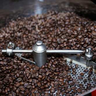 Freshly roasted coffee beans in a coffee roaster